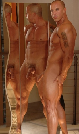 Naked bodybuilder showing off in front of a mirror