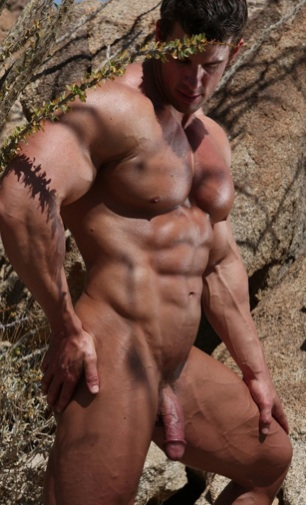 Sexy body builder Zeb Atlas stands tanned and toned