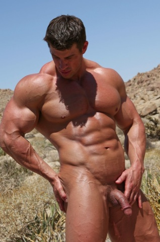 Extremley muscular Zeb Atlas oiled and naked outside.