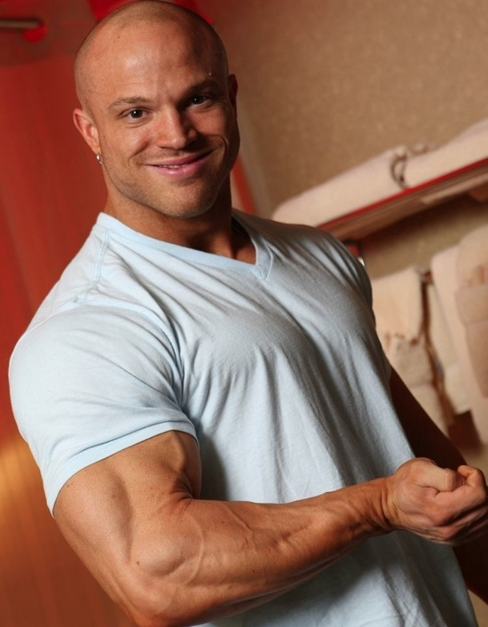 Bodybuilder Kyle Stevens flexes his huge arm muscle