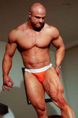 Bodybuilder Kyle Stevens in underwear showing his extremely muscular legs