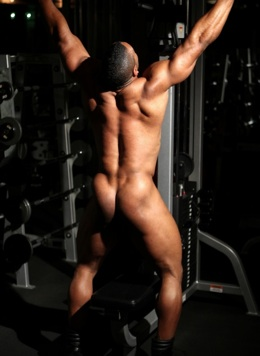 Naked black bodybuilder  Alan Demond works on his arms and shows his ass