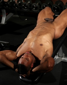 Sexy black bodybuilder lying down after a hard workout