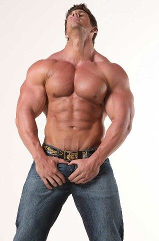Smooth bodybuilder grabing his crotch