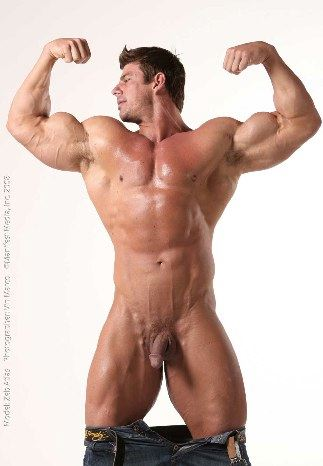 Smooth bodybuilder flexes his huge biceps