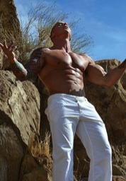 Vin shirtless outside in the desert