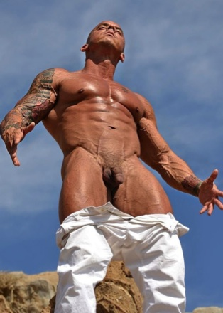 Inked muscled stud Vin Marco sunning himself in the desert