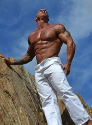 ultra ripped bald stud under the desert sun