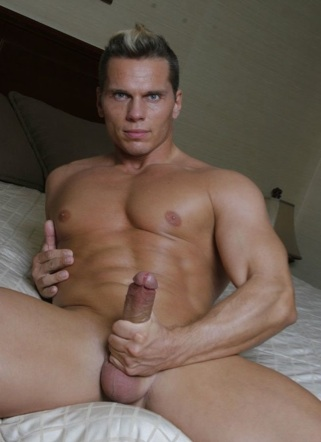 Jasper stroking his hard cock on bed