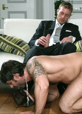 Axel Brooks licks Neil Steven's shoes while he massages his uncut dick