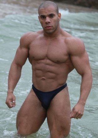 Ripped bodybuilder Lucius Blaque in the ocean