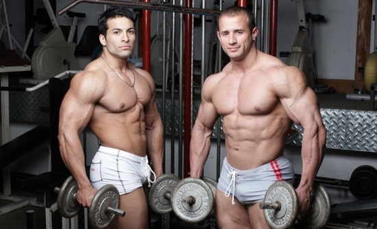 muscle hunks posing for the camera