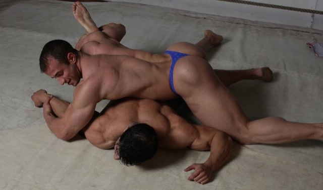 Huge muscle boys wrestling