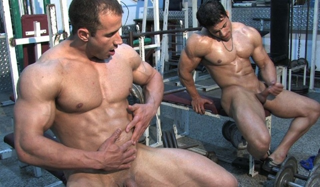 Two hot young bodybuilders stroke thier dicks