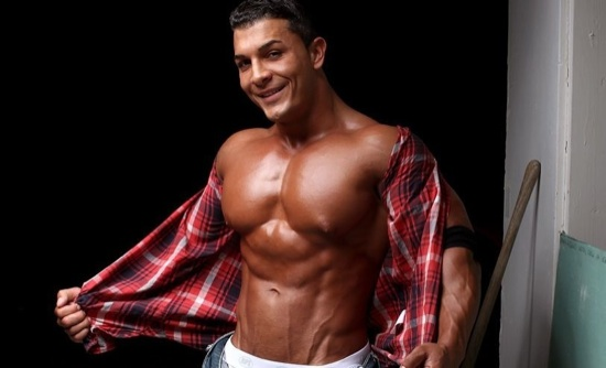 Omar strips off his shirt to show off his huge chest