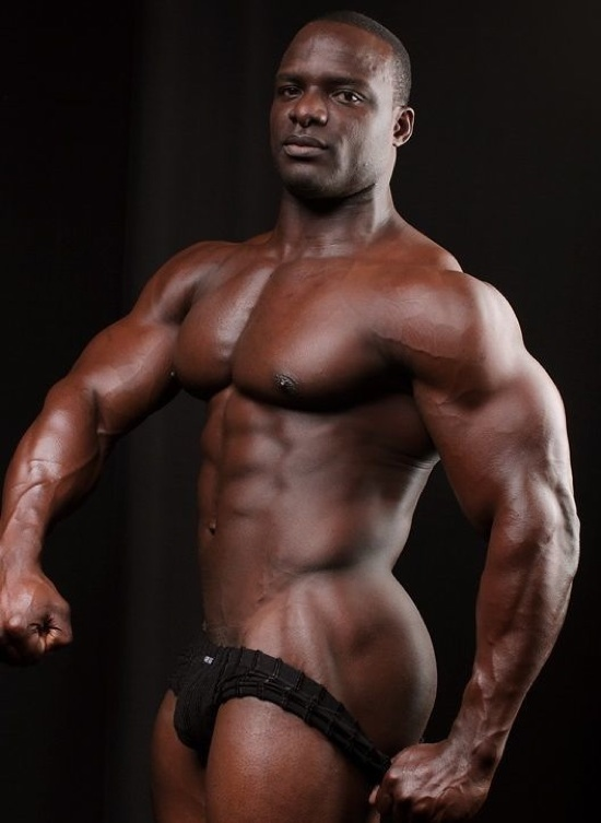 Muscle hunk Barry flexes his impressive chest and arms