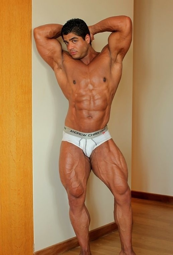 Ripped bodybuilder Brutus Difino  flexing his massive muscles