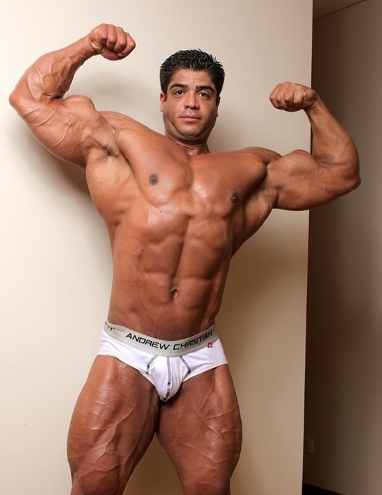 Brutus Difino flexing his huge arms and chest