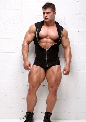 Beefy young bodybuilder shows off his massive legs