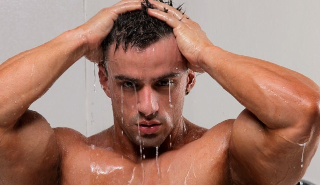 Hot young bodybuilder dripping wet