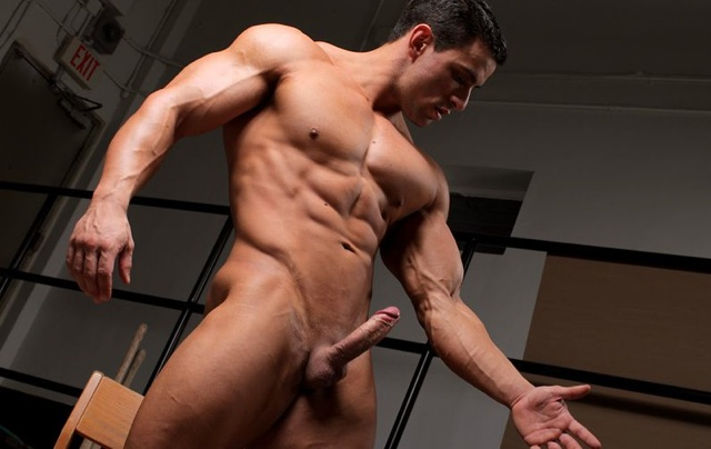 Macho flexes his arms with his hard cock out
