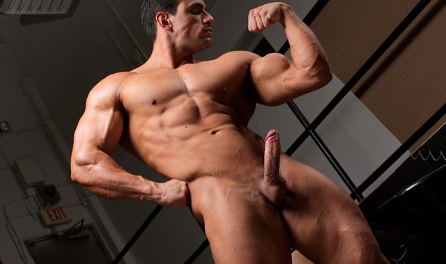 Macho with a hard on flexing his huge biceps