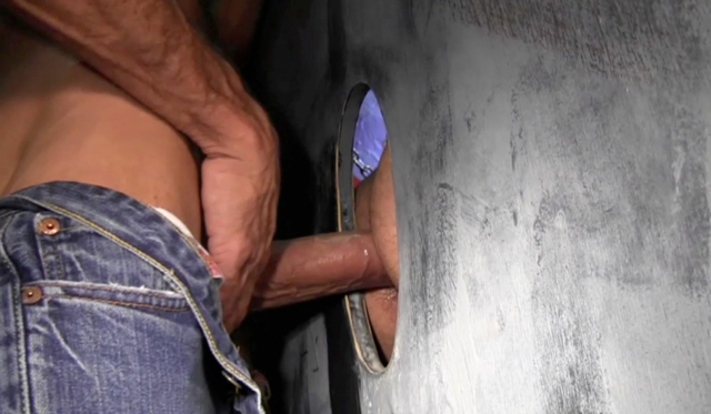 Lito slides his cock into Nick's ass through the glory hole