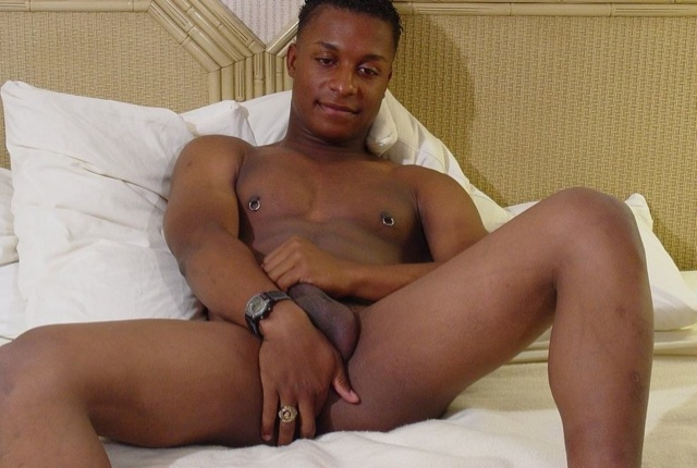 Young Black jock fingers his tight hole while stroking his dick