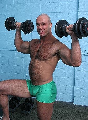 Muscle bear lifting weights