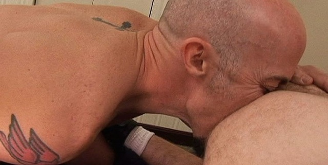 Brad McGuire digs deep into James Roscoe's hole with his tongue.