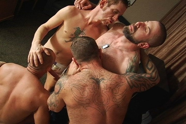 Four tatted pigs sucking and licking each other