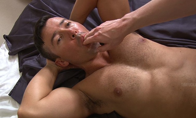 Dominik Rider licking a top's cummy fingers