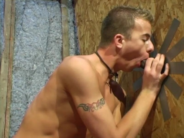 Jarrod Steel sucking cock though a glory hole
