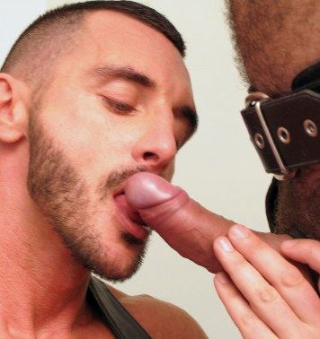 Bearded Ross Stevens licks the head of an uncut dick