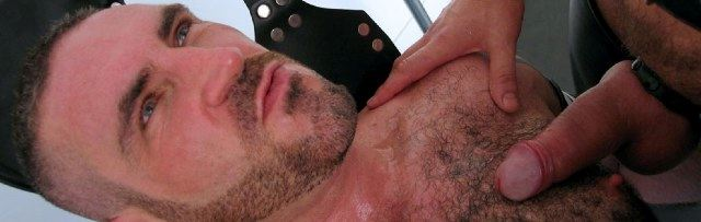 Hairy chested bottom gets a top's load of cum on him