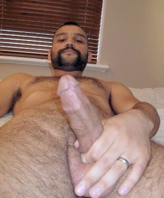 Hairy young cub strokes his hard dick
