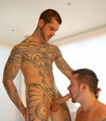 Inked stud Logan getting his huge hard cock sucked by Vinnie