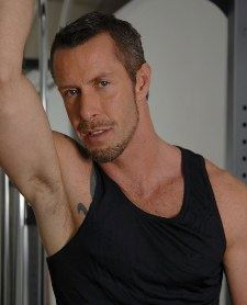 Bearded stud Rocco Banks in a black tank top