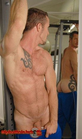 Rocco Banks admires his ass in a mirror