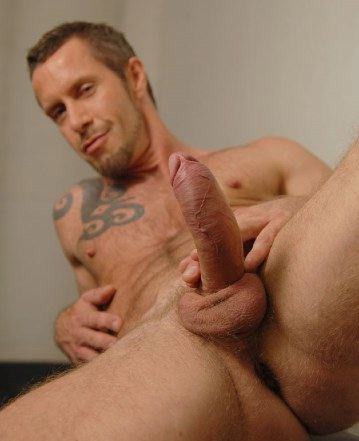 Rocco Banks showing off his big thick uncut cock