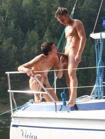 Muscular jock gets his dick licked by a cocksucker on the stern of a boat