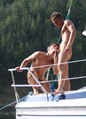 Two jocks have oral sex on the stern of a sailboat