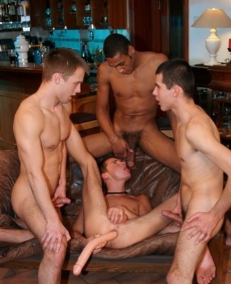 Young guy plays with a toy in his ass while others jerk off around him