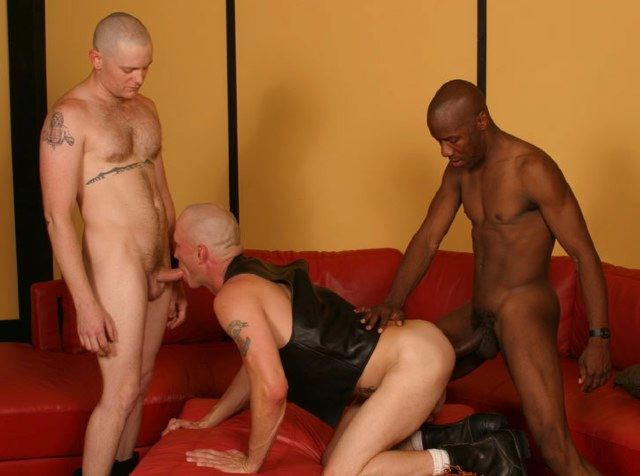 Sex pig spit roasted by a black guy and a tattooed white guy