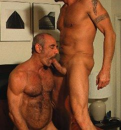 Hot hairy daddy sucking a beefy guy's dick