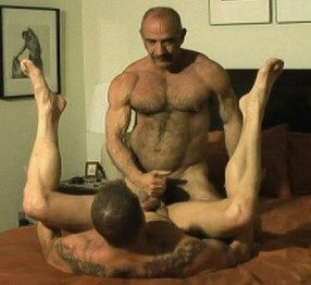 Hairy muscle top Tony DeAngelo gets ready to fuck David Griffen who's got his legs in the air waiting to get fucked