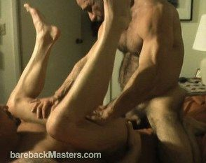 Hairy musclely top fucks a bottom with his legs in the air