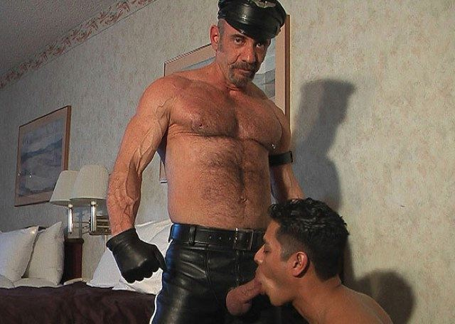 Leather Daddy Anthony getting his hard cock serviced