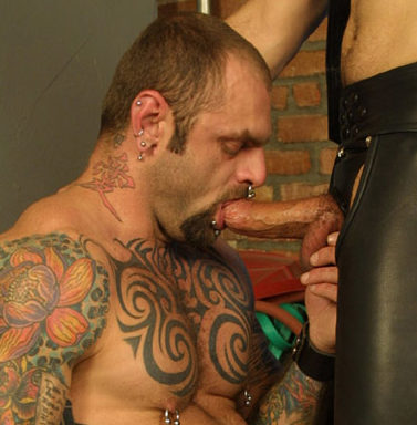 Tatted pig Bud on his knees sucking dick