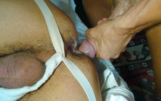 Hairy young ass getting warm cum shot on it